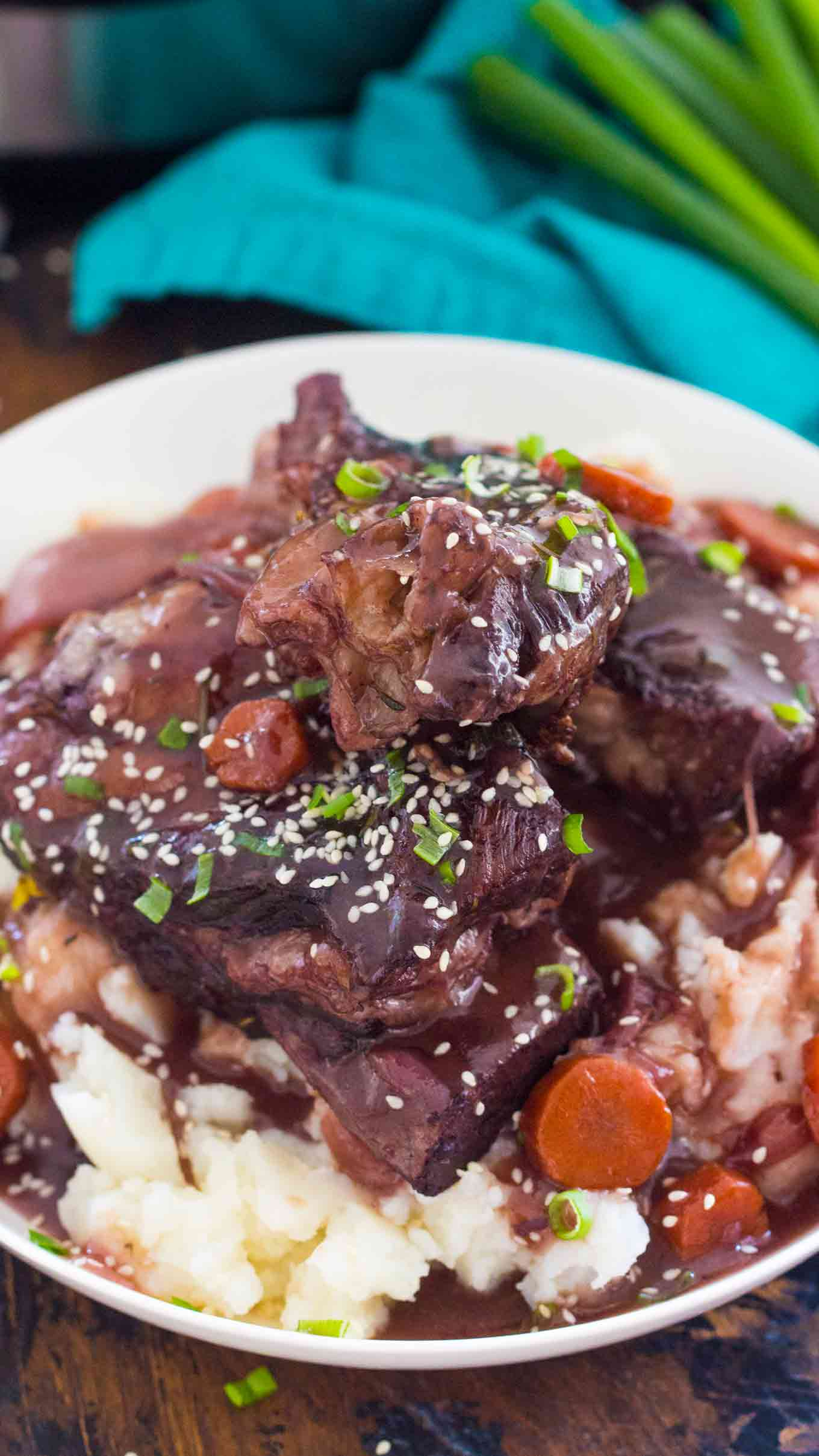 Best Instant Pot Short Ribs are juicy and fall of the bone, cooked in the most amazing garlic and wine sauce, and ready to eat in just 2 hours!