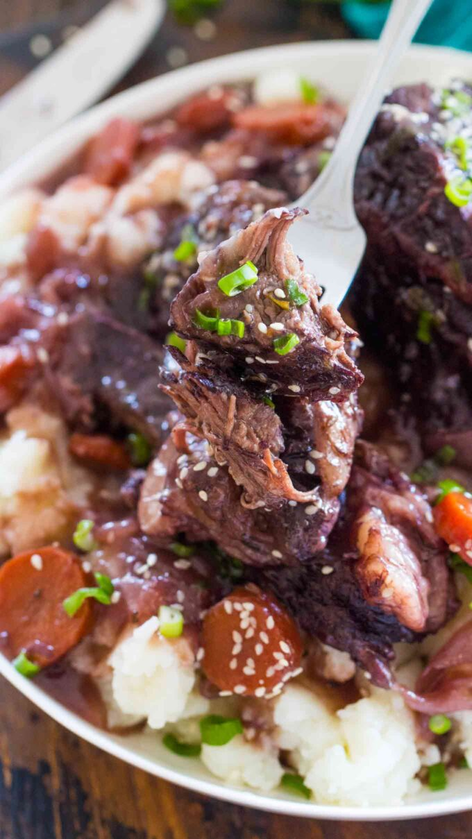 Image of short ribs cooked in the instant pot with mashed potatoes and carrots.