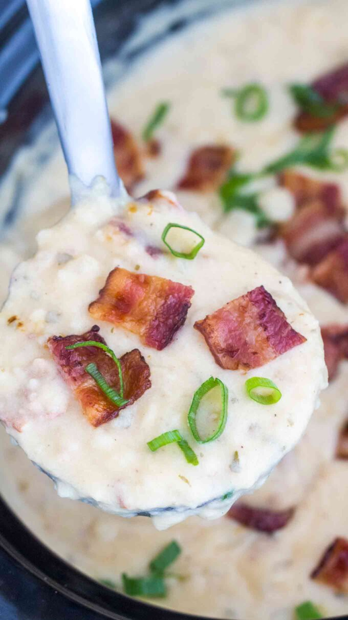 image of slow cooker baked potato soup topped with bacon and chopped green onion