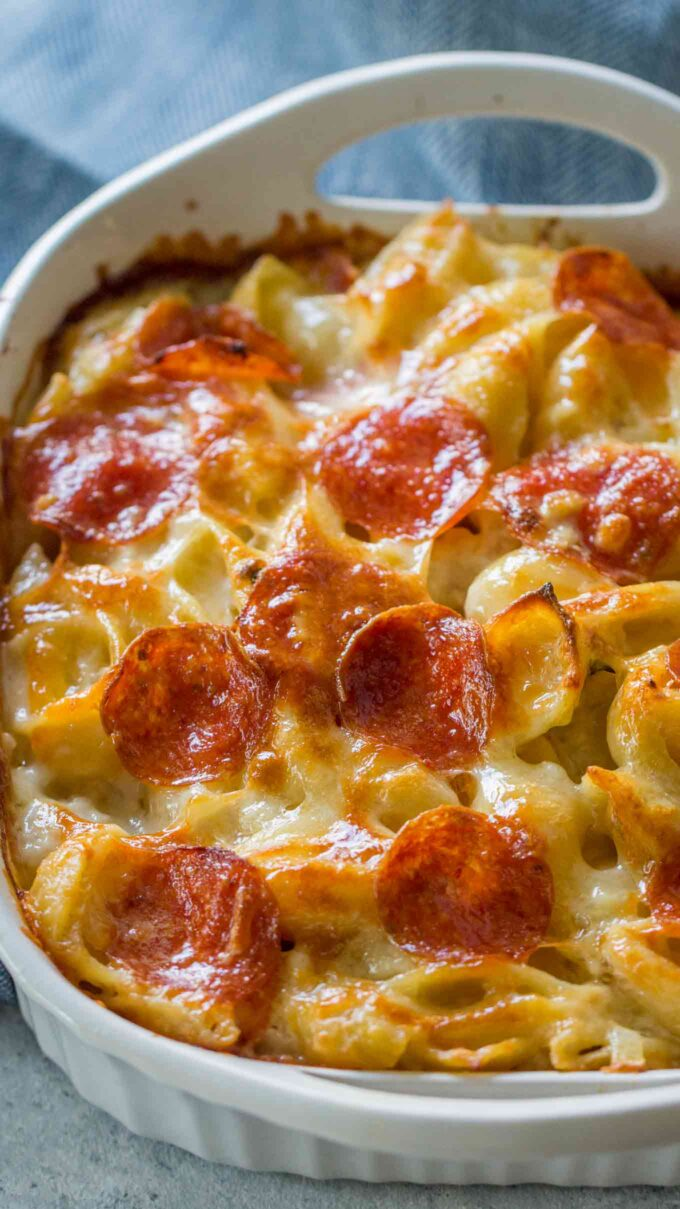Photo of white pizza casserole with pepperoni.