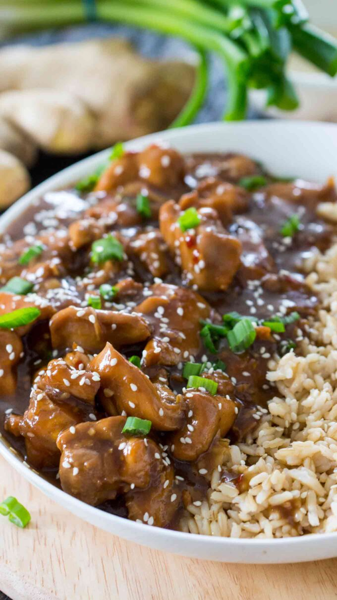 Image of garlic sesame chicken made in the pressure cooker over brown rice.