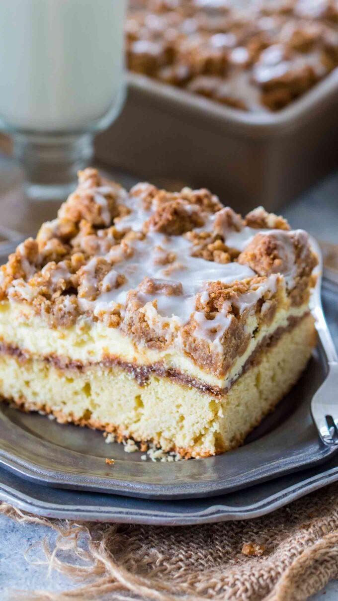 image of sliced coffee cake with streusel topping on a silver plate