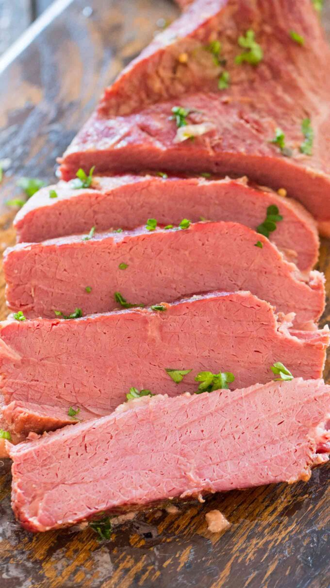 Sliced Instant Pot Corned Beef on a wooden board