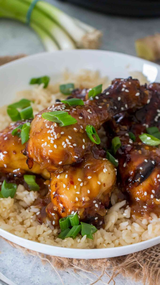 Photo of Mongolian drumsticks over brown rice.