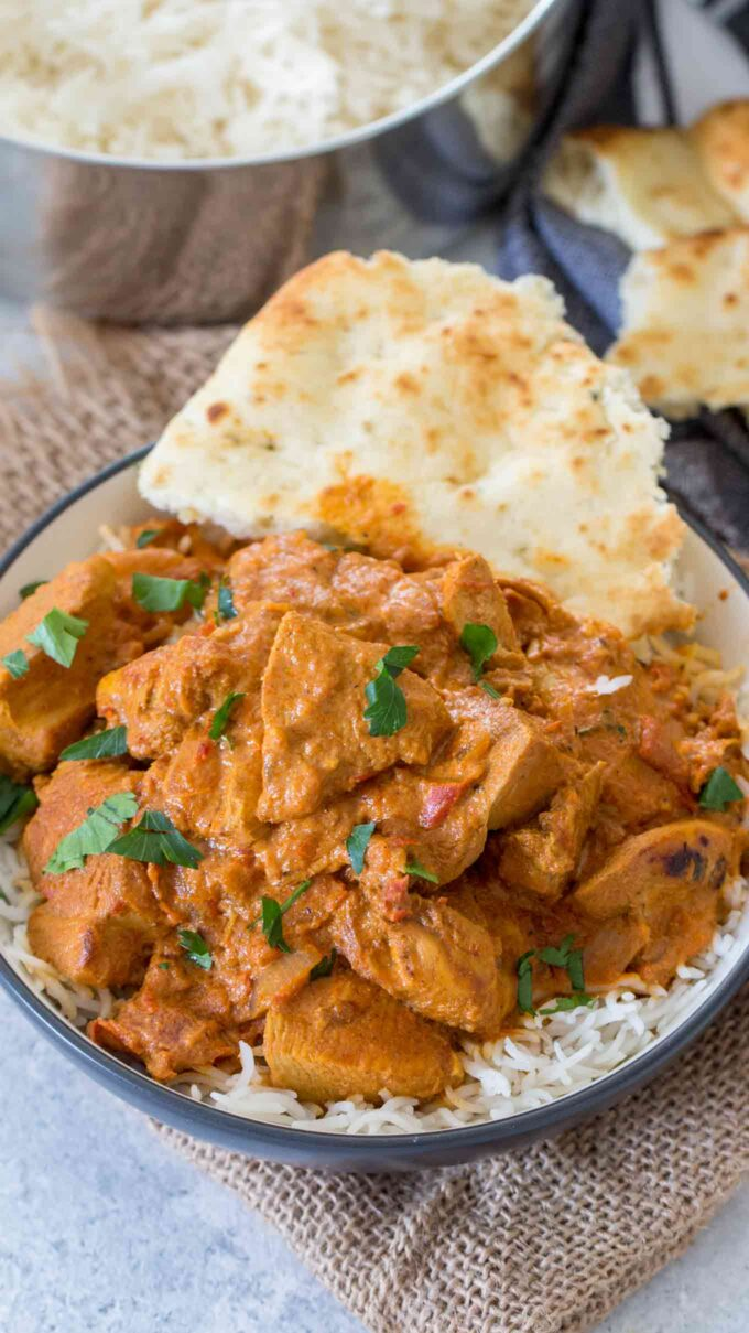 Pressure cooker chicken tikka masala over white rice and naan.