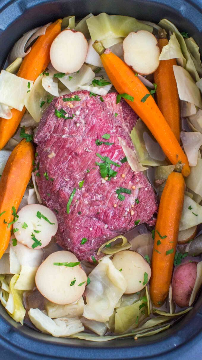 image of slow cooker corned beef with cabbage potatoes and carrots