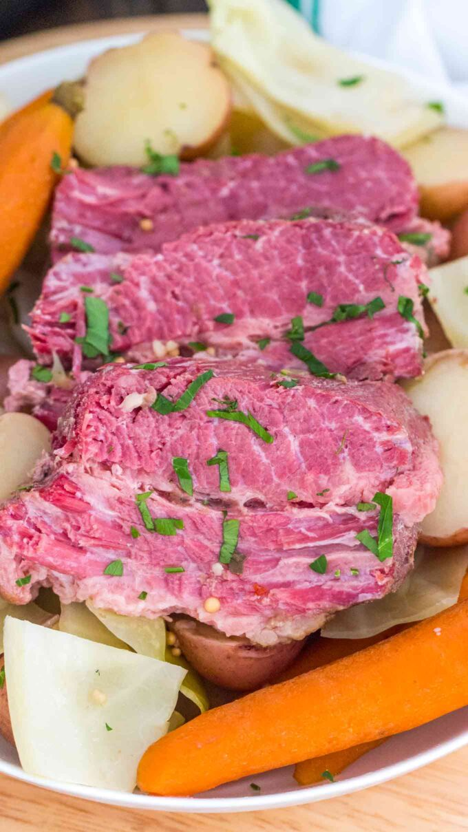 image of cut corned beef with cabbage potatoes and carrots on a plate