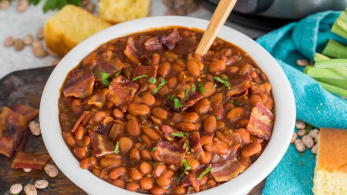 Picture of pressure cooker instant pot baked Beans in a white bowl.
