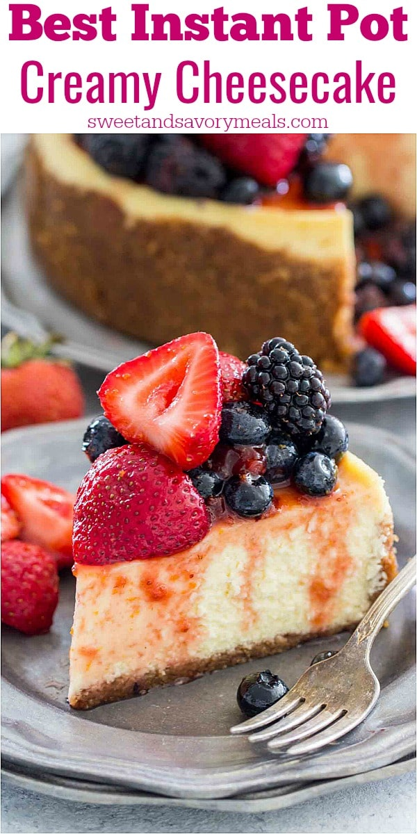 Picture of a slice of cheesecake topped with berries on a silver plate.