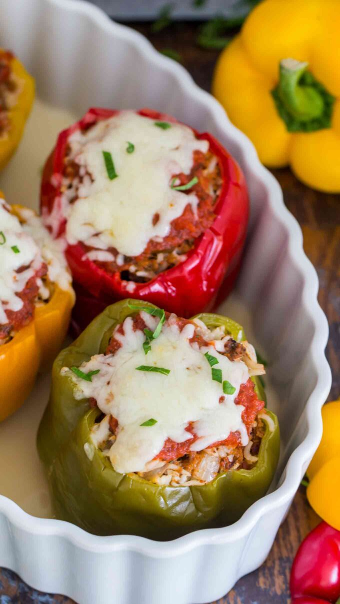 image of cooked stuffed peppers topped with melted cheese in a casserole dish