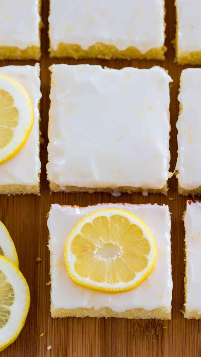 Photo of glazed lemon brownies bars.