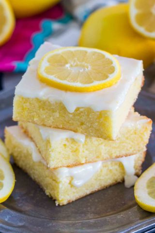 Easy to make One Bowl Lemon Brownies are so buttery and full of fresh lemon flavor. Made with fresh lemon juice, lemon zest and topped with lemon glaze.