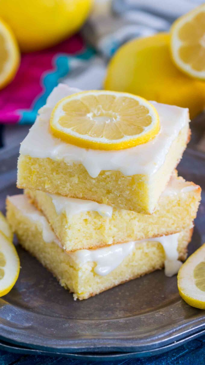 Image of sliced lemon bread brownies on a silver plate.