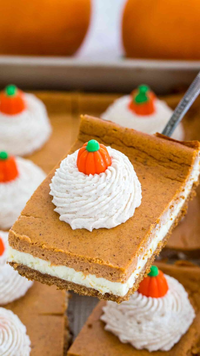 Pumpkin cheesecake bars filled with cream cheese