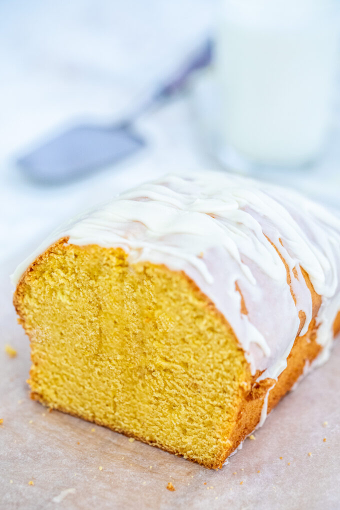 Pumpkin Pound Cake is sweet, buttery and full ofpumpkin pie flavor. Topped with a hefty amount of white chocolate whipped ganache, makes it the perfect fall treat. #pumpkin #pumpkinspice #falldesserts #poundcake #sweetandsavorymeals