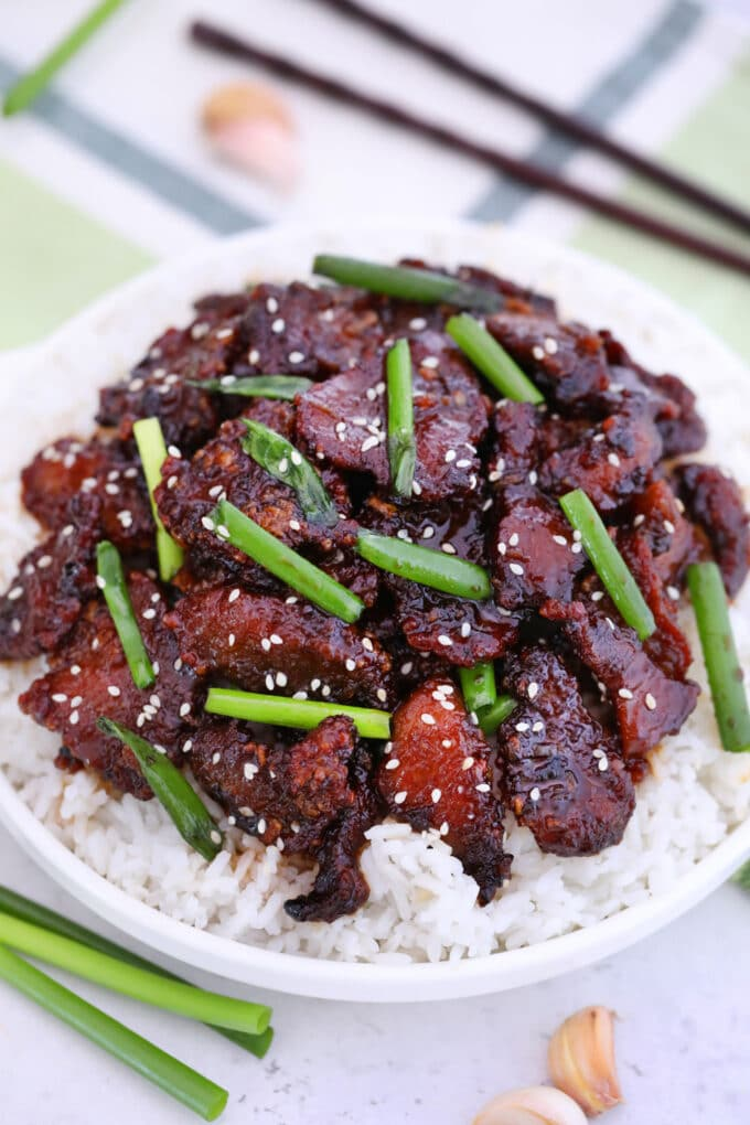 Image of mongolian beef with sesame seeds over white rice