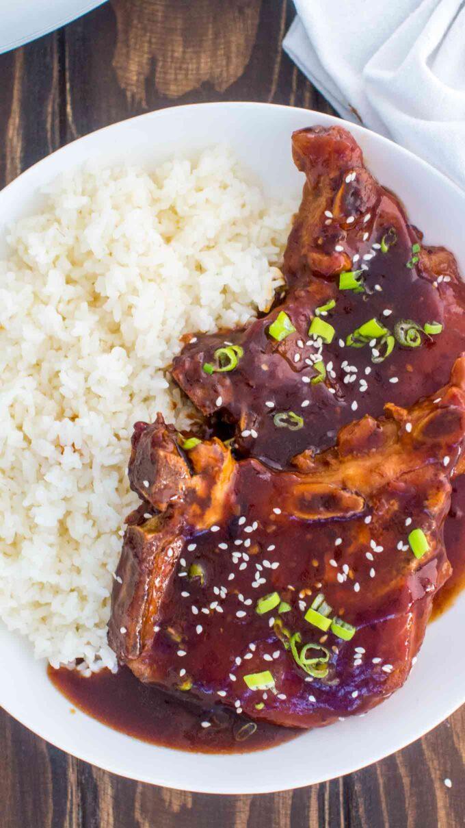 homemade pork chops in teriyaki sauce over white rice