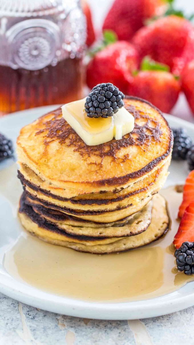 Image of keto pancakes topped with butter and berries.