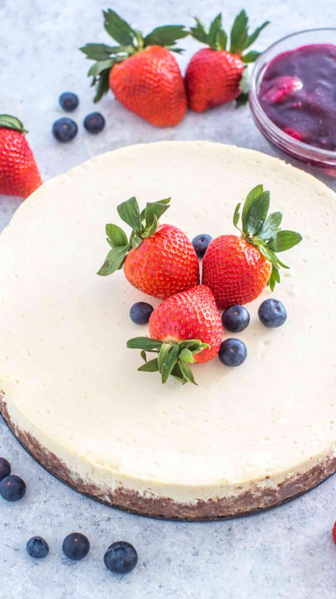 Image of keto cheesecake topped with strawberries.
