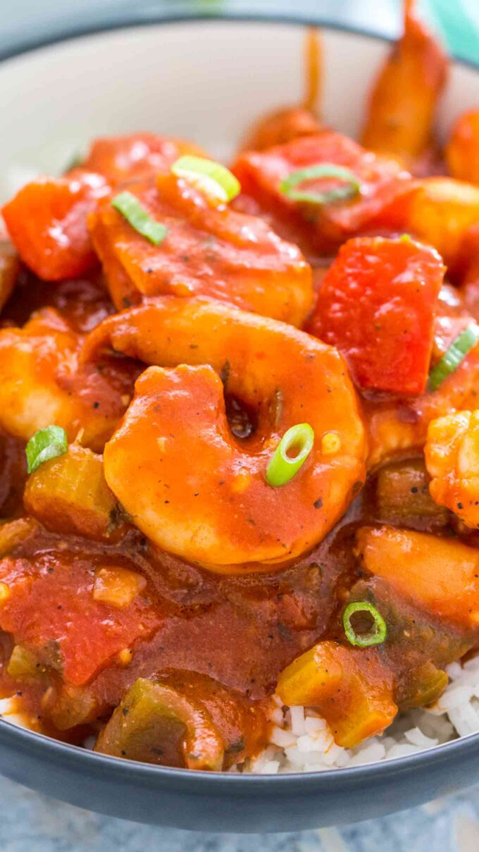 Shrimp creole over white rice photo.