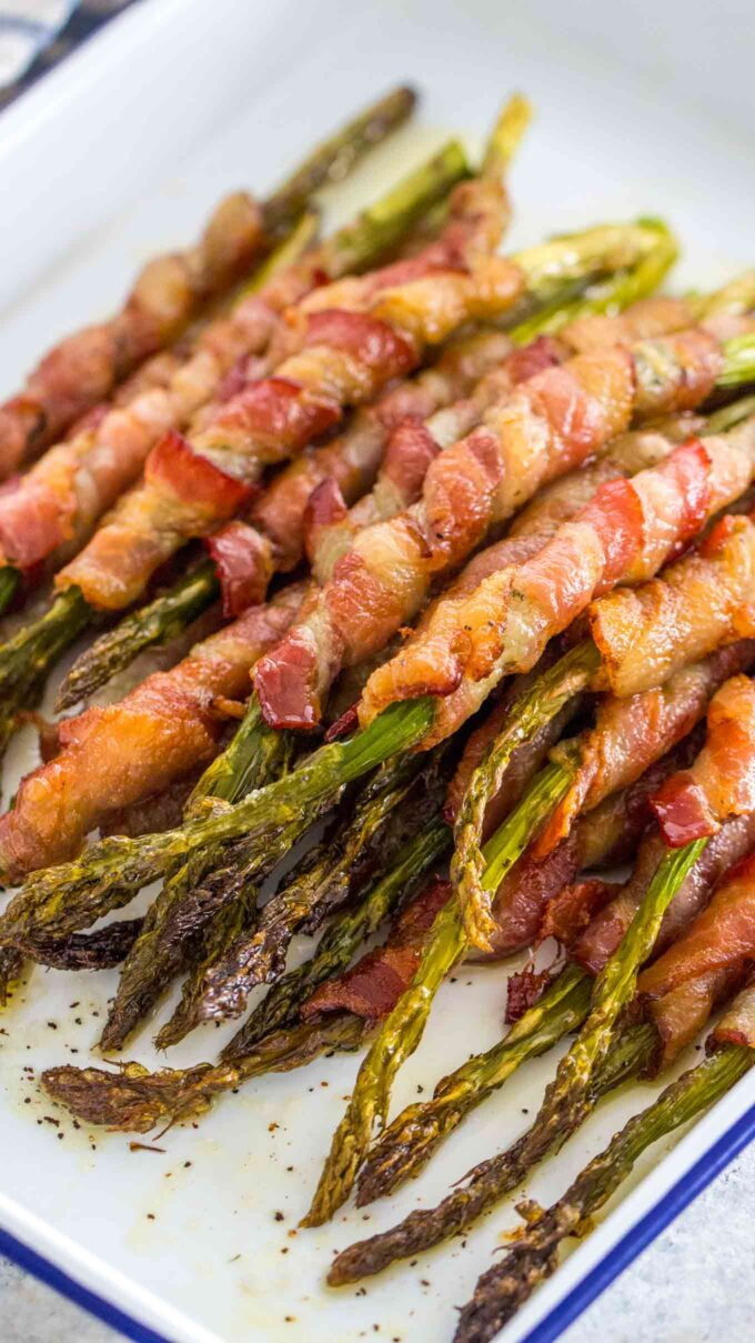 Picture of homemade baked asparagus wrapped with bacon.