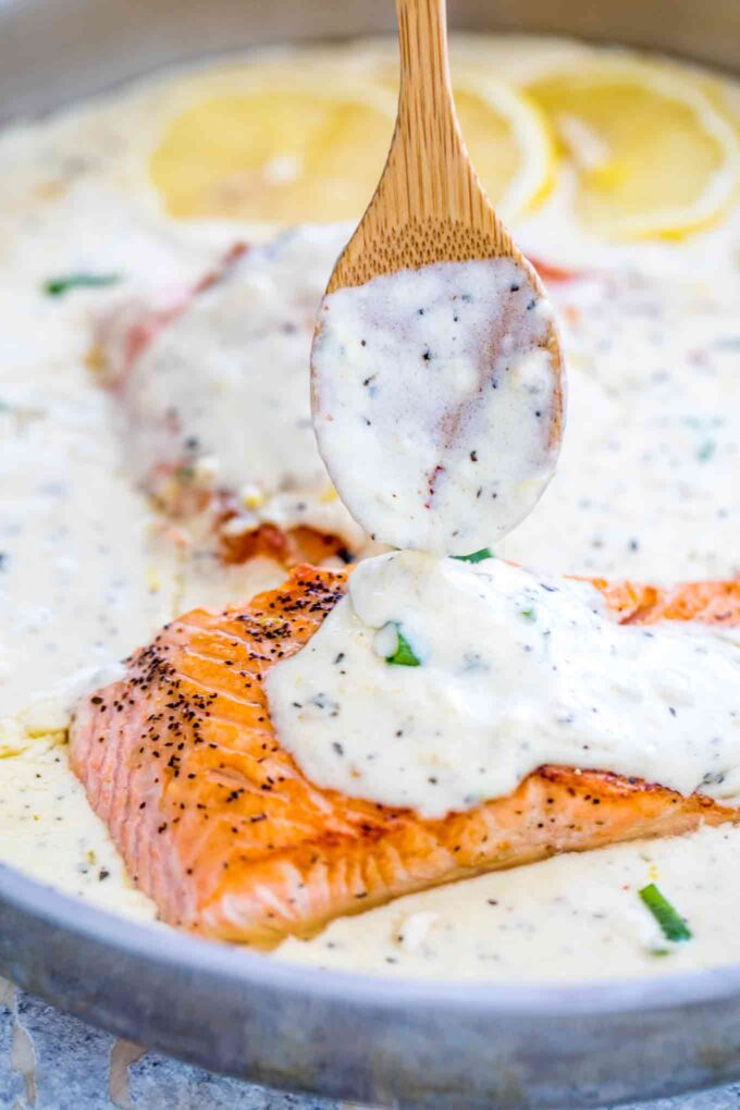 Picture of salmon cooked in a creamy lemon garlic sauce.