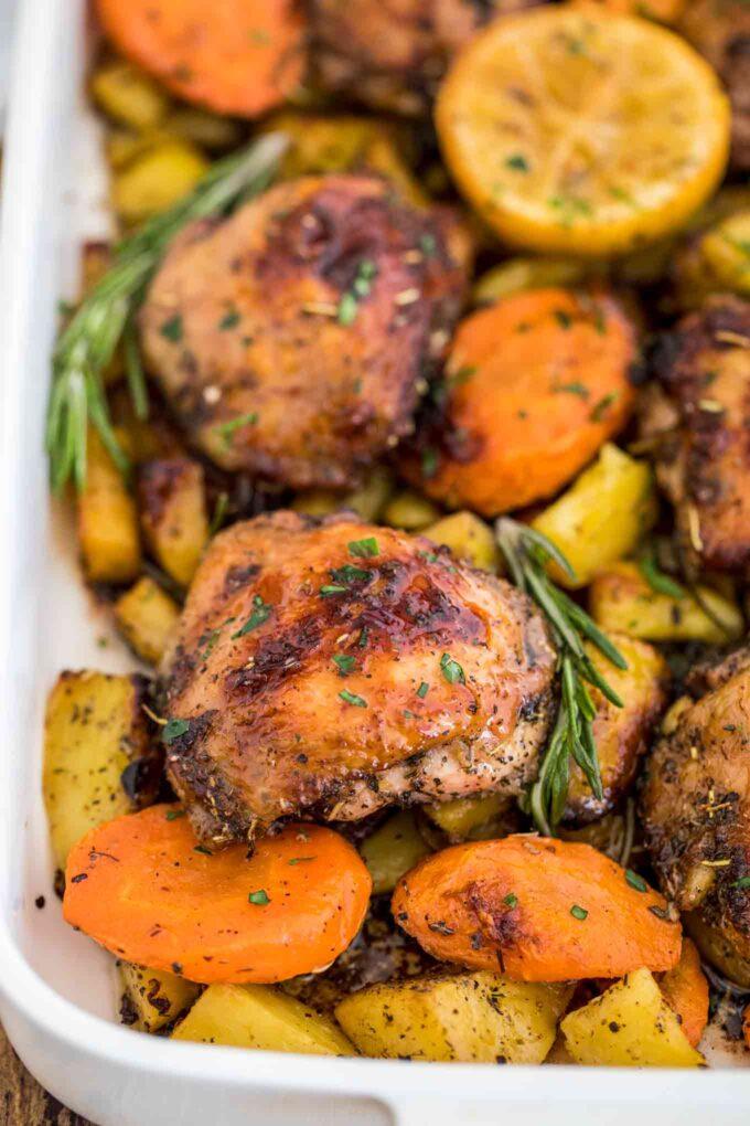 Italian chicken with potatoes carrots and rosemary photo.