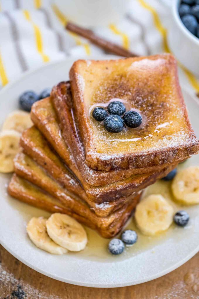 Image of french toasts with honey banana and blueberries.