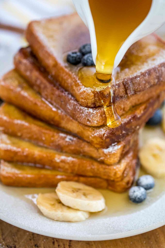 Homemade french toast with honey and blueberries photo.