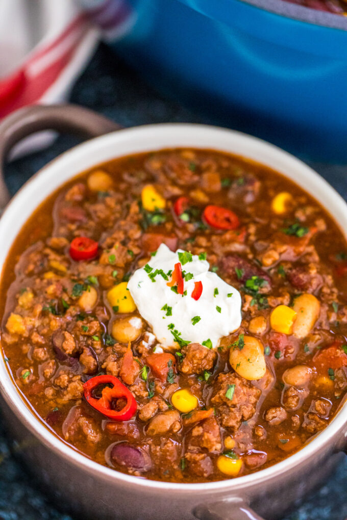 A bowl of homemade beef chili topped with sour cream.