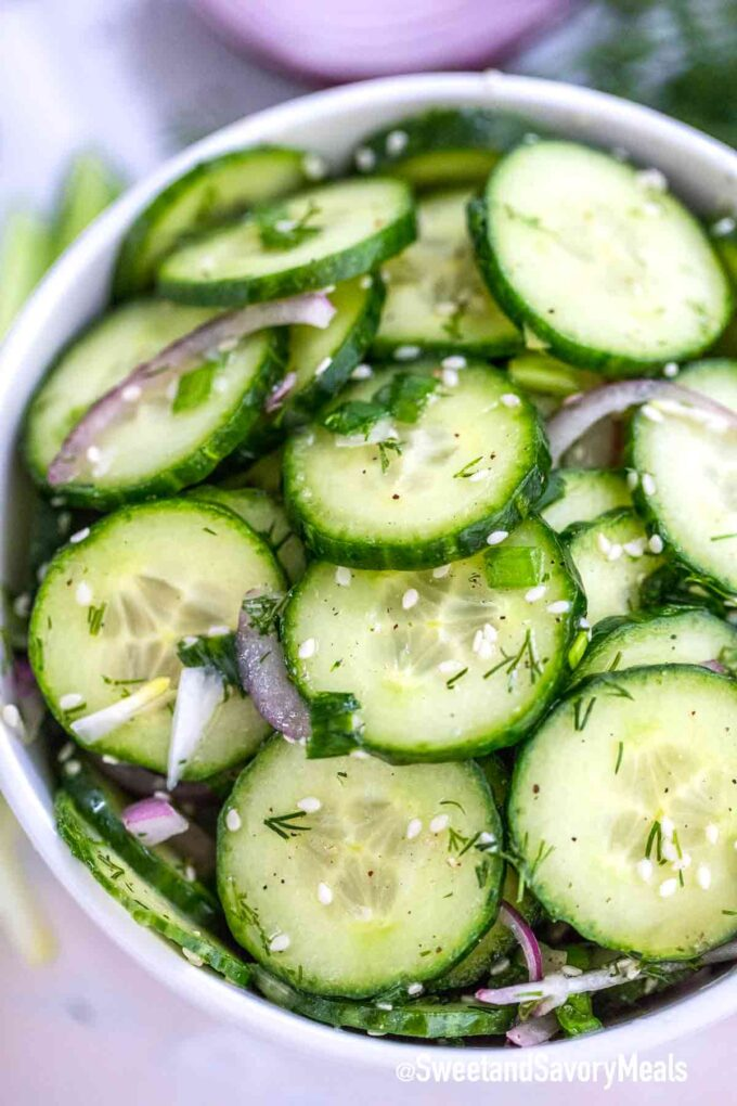 close-up of cucumber salad with green onion in a bowl.