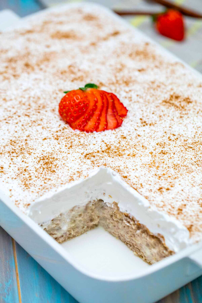 Photo of tres leches cake with whipped cream.