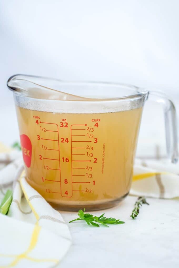Photo of freshly made chicken stock in a cup.