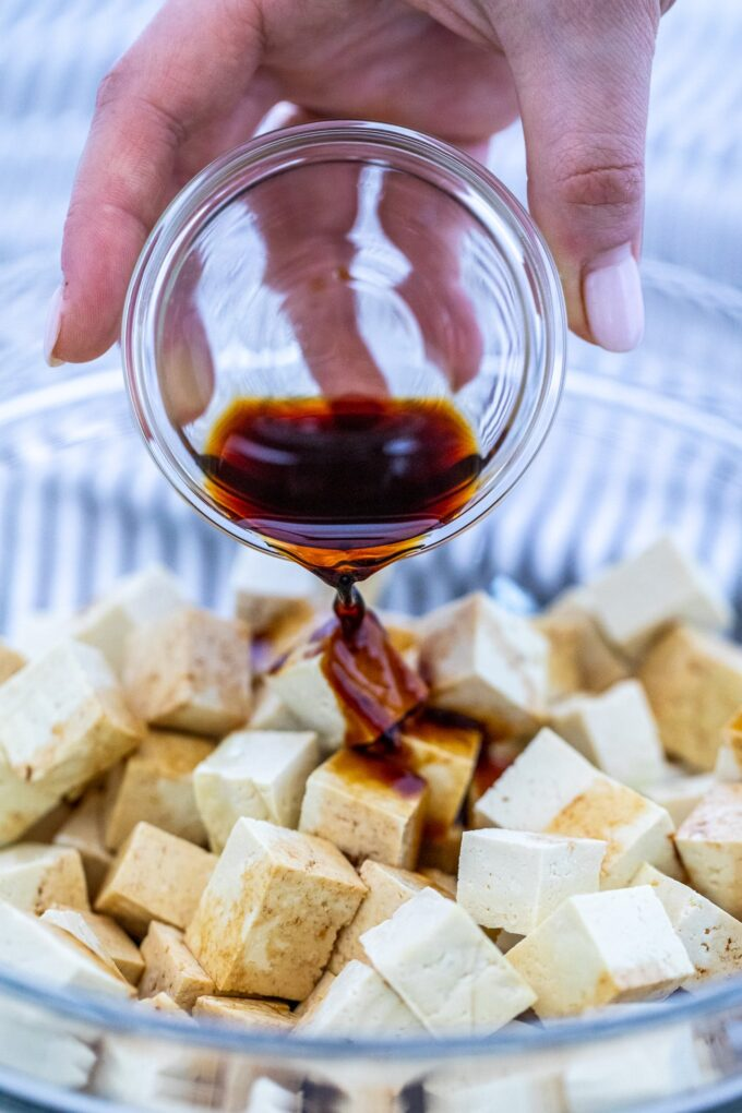 Image of cubed tofu with soy sauce in a bowl.