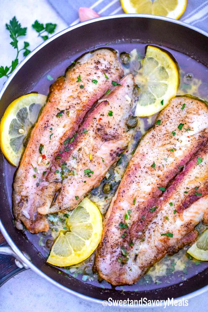 frying Swai fish in a skillet with lemon and capers