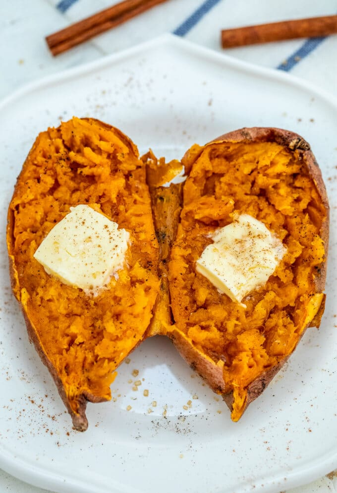 Photo of sweet potato topped with butter and cinnamon.