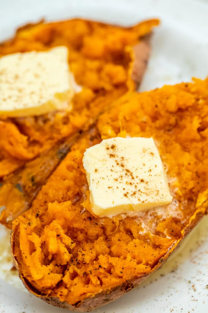 Image of microwaved sweet potato topped with sliced butter.