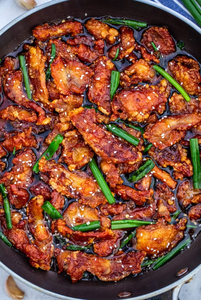 Mongolian chicken in a skillet photo.