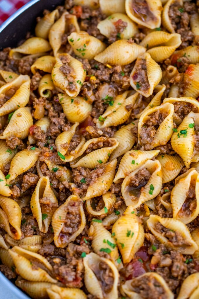 Picture of beef taco pasta garnished with chopped parsley.