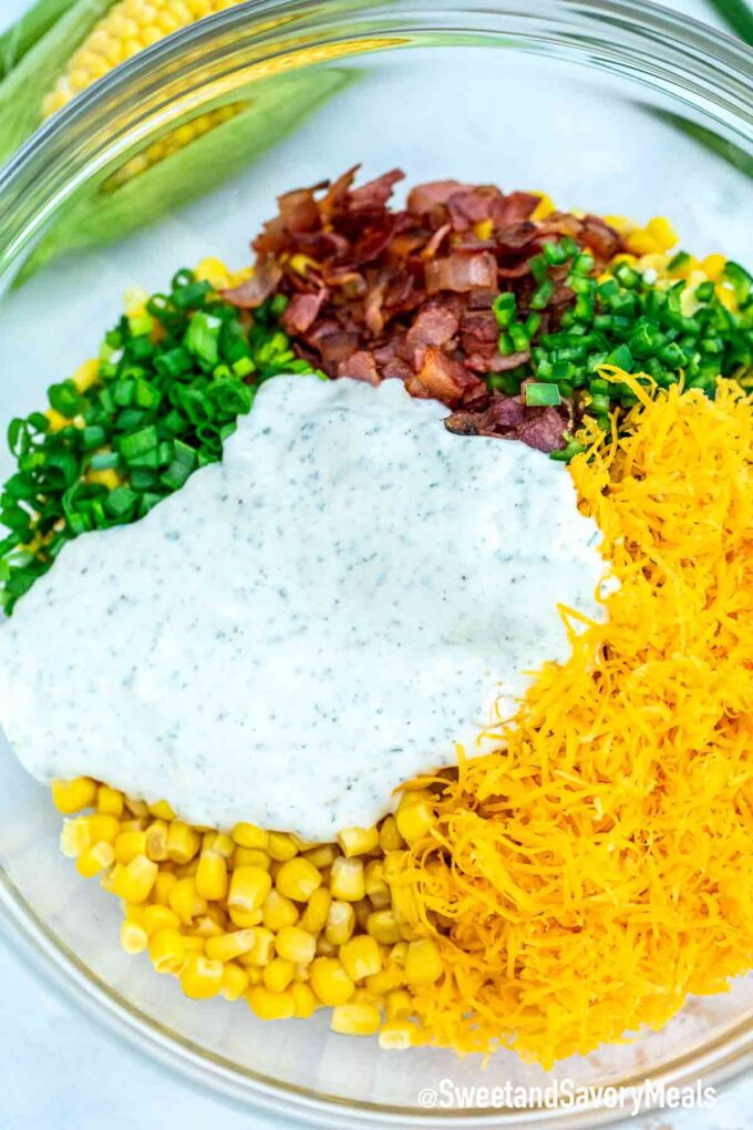 bacon ranch cheddar cheese corn salad ingredients in a bowl