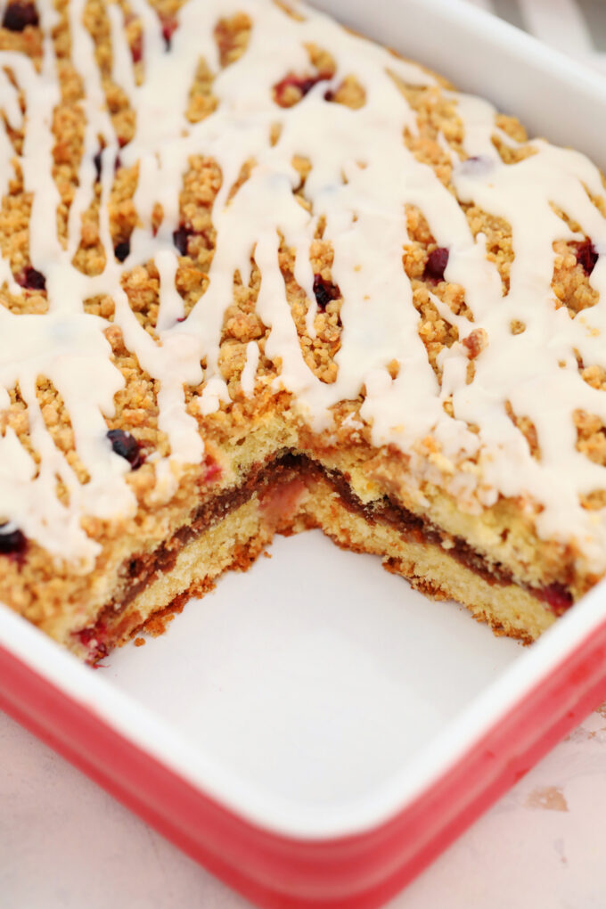 Cranberry Coffee Cake is the perfect fall desserts to partner with your favorite coffee! It is moist, sweet, and tart at the same time, and very easy to make! #coffeecake #cranberries #falldesserts #sweetandsavorymeals #thanksgiving