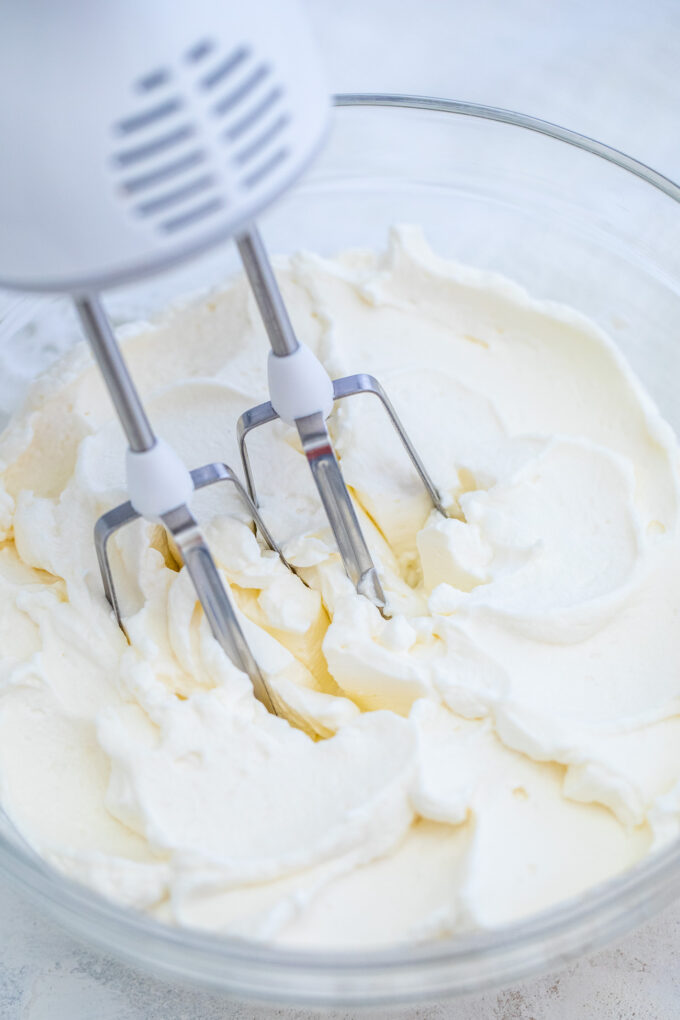 Whipped Cream is sweet, fluffy, and smooth! Learn how to make it at home using minimal ingredients. #whippedcream #cream #frosting #desserts #sweetandsavorymeals