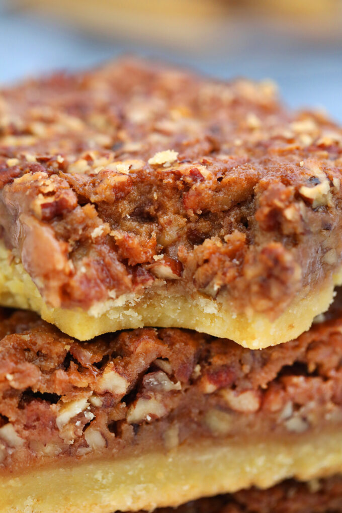 Pecan Pie Bars are sweet, nutty, crunchy and buttery! Serve this American favorite dessert at your Thanksgiving and Christmas gathering! #pecanpie #pecanpiebars #sweetandsavorymeals #pecans #thanksgivingrecipes #fallrecipes