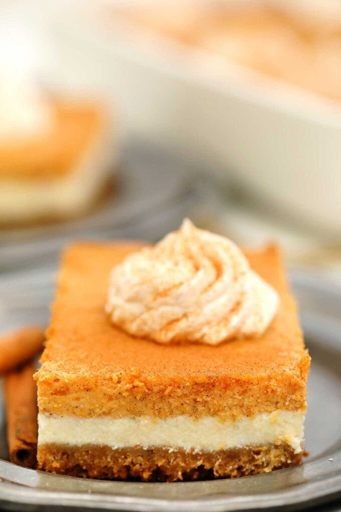 Sweet Potato Cheesecake Bars have layers full of creamy goodness! Topped with a cinnamon whipped cream, this dessert will never fail to please a crowd! #cheesecake #sweetpotatoes #thanksgiving #thanksgivingrecipes #fallrecipes #sweetandsavorymeals