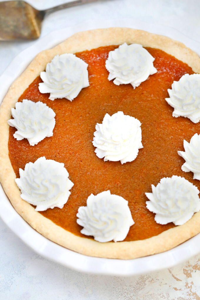 Sweet Potato Pie has a buttery crisp crust and creamy filling with nutmeg, cloves, ginger, and cinnamon. This is the perfect dessert to enjoy for Thanksgiving and Christmas.#thanksgivingrecipes #sweetpotatoes #sweetpotatopie #christmasrecipes #sweetandsavorymeals