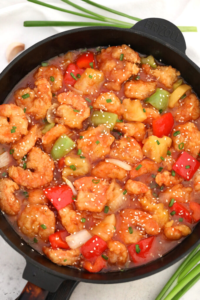 Sweet and Sour Shrimp is made with golden-crispy shrimp, healthy veggies, and coated in a delicious sweet and sour sauce. #shrimp #sweetandsour #sweetandsaourshrimp #chinesefood #sweetandsavorymeals