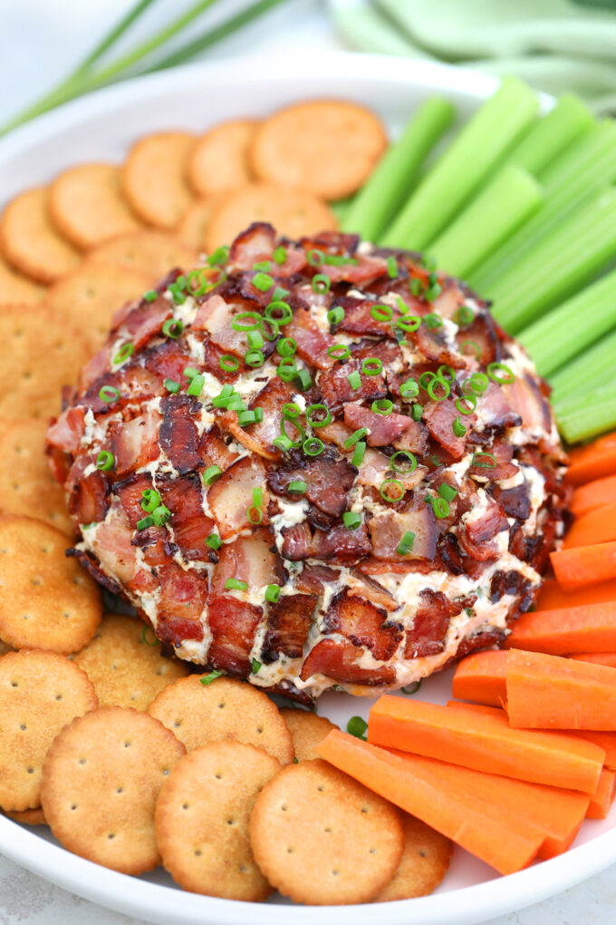 Bacon Ranch Cheese Ball is a creamy and flavorful ball of your favorite cheese combined with cream cheese and crispy bacon! #cheese #cheeseball #appetizers #baconranch #sweetandsavorymeals
