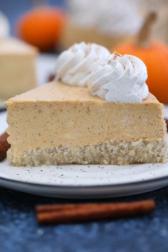 Keto Pumpkin Cheesecake is a low-carb and perfectly smooth dessert that is great for Thanksgiving. #keto #thanksgiving #ketocheesecake #cheesecake #pumpkin