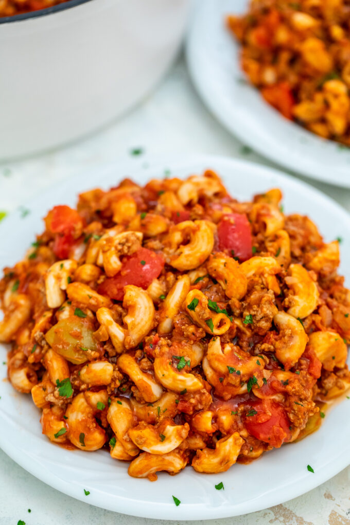 Goulash is a traditional Hungarian recipe that has an American version that is equally hearty and delicious! It is the perfect comfort food for the cold season! #goulash #onepotrecipe #pasta #sweetandsavorymeals #30minutemeals