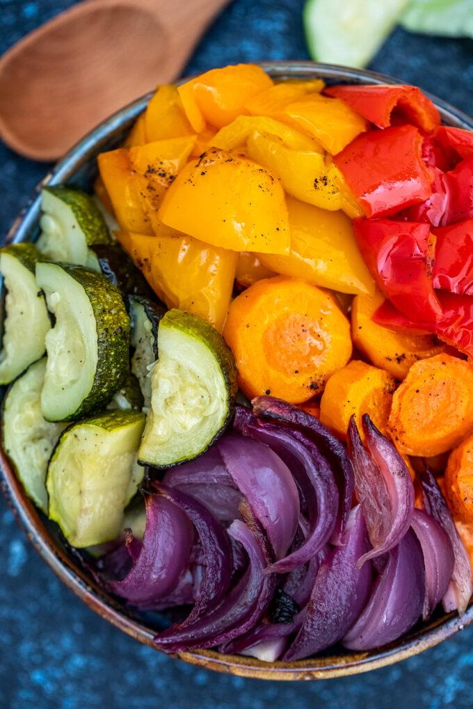 Rainbow Roasted Vegetables are a fun and easy way to feast on healthy fiber! Not only are they colorful, but they are flavorful and nutritious, too! #vegetables #rainbowvegetables #sidedish #vegetarianrecipes #sweetandsavorymeals